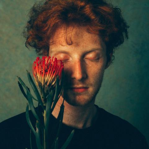 Adrien with flower